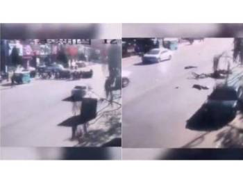 Imej rakaman CCTV kemalangan membabitkan sebuah kereta merempuh sekumpulan pelajar sekolah yang melintas jalan di Huludao