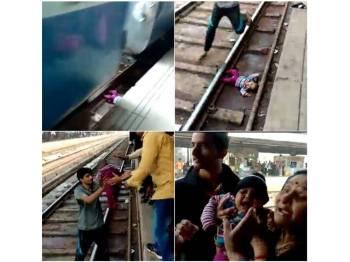 Bayi berkenaan tidak mengalami sebarang kecederaan selepas terjatuh di landasan kereta api. - Foto AFP