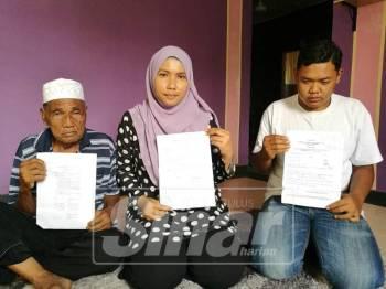Masnah (tengah) memohon pihak berkenaan mempermudahkan permohonan kad pengenalan adik tirinya.