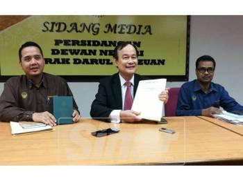 Koo Ham (tengah) pada sidang media, hari ini.