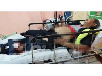 Keadaan Ketua Balai Polis Lubok Cina, Sarjan Mejar Abd Rasid Hasan, 55, selepas terlibat kemalangan di hadapan Sekolah Kebangsaan Lereh, Klebang di sini, semalam.