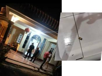 Anggota polis melakukan siasatan di lokasi kejadian serta kelongsong peluru (kanan) yang ditemui di dalam kediaman mangsa.