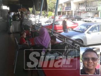 Sinar Harian merakam situasi seorang perokok yang menghormati arahan larangan merokok di tempat awam apabila keluar dari premis restoran bagi tujuan itu. (Gambar kecil: Mohd Shahrul)
