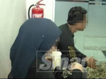 Antara pasangan yang ditahan berkhalwat oleh JAIM dalam bilik hotel murah di Batu Berendam, di sini, awal pagi tadi.