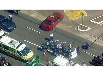 Pihak polis Australia berada di lokasi kejadian. - Foto Reuters
