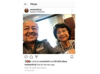 Tun Mahathir dan isteri