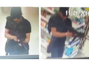 Rakaman CCTV menunjukkan suspek memegang objek dipercayai senjata api.