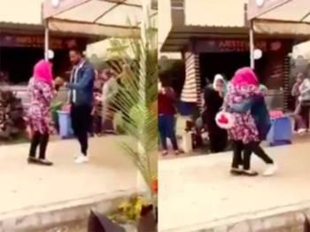 Rakaman video pelajar wanita terbabit memeluk lelaki yang tular dan mencetuskan bantahan awam.