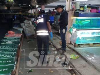 Anggota polis melakukan siasatan di tempat kejadian di Flat MBPP, Jalan Patani, malam tadi.