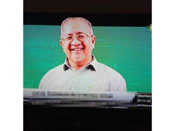 Gambarnya disiarkan dalam sebuah televisyen berhubung kes tersebut.
