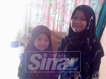 Nur Fatihah (kanan) dan adiknya yang hilang selepas keluar dari rumah mereka tiga hari lalu.