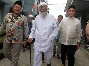 Abu Bakar (tengah) dijatuhi hukuman penjara 15 tahun pada 2011.
