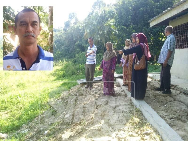 Penduduk menunjukkan sempadan tapak kuari yang terlalu hampir dengan rumah mereka. (Gambar kecil:  Shukri Md Janan)