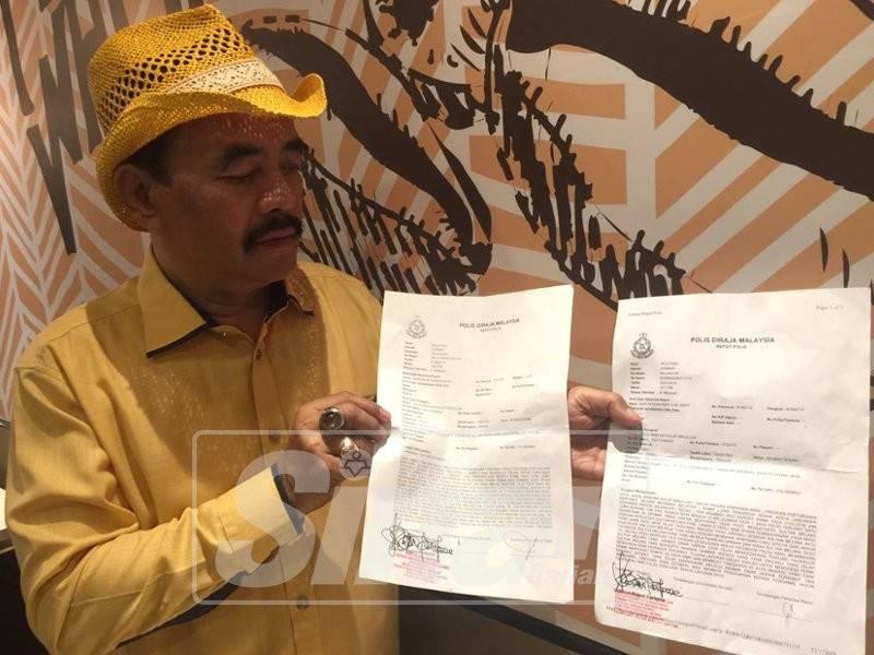 Noor Jan menunjukkan laporan yang dibuat pada 22 Januari lalu di Balai Polis Gombak.
