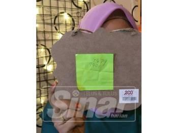 Ida menunjukkan kepingan kertas bertulis nombor yang diberi geng pukau terbabit.