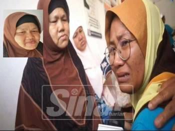 Nurdiana Alwani (kanan) tidak dapat menahan sebak selepas berjumpa dan memohon maaf dari ibu mangsa, Masitah.