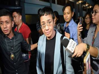 CEO Rappler Maria Ressa, ditahan atas tuduhan melakukan fitnah siber. - Foto AFP
