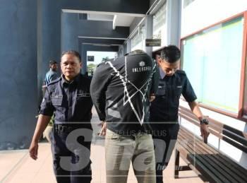 Muhammad Firdaus dibawa keluar dari Mahkamah Majistret Ipoh selepas dituduh membunuh seorang lelaki, tiga tahun lalu.