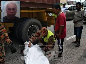 Anggota Balai Bomba dan Penyelamat Bagan Serai bertindak melitupi mayat mangsa dengan kain putih susulan terbabit kemalangan dengan sebuah treler tengah hari tadi. Gambar kecil: Masri