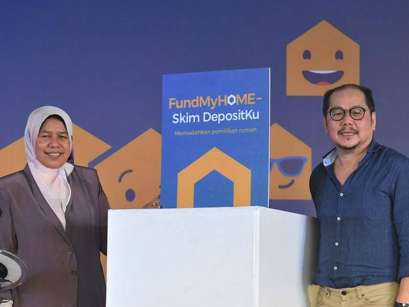Menteri Perumahan dan Kerajaan Tempatan Zuraida Kamaruddin (kiri) merasmikan FundMyHome-Skim Depositku hari ini. - Foto Bernama