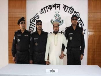 Suspek akhirnya dicekup polis.