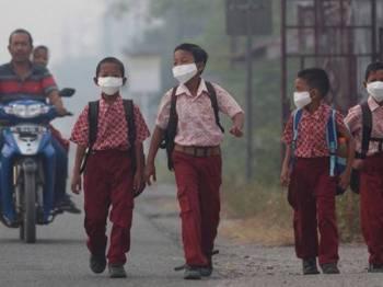 Pentadbiran wilayah Riau terpaksa menutup sekolah kerana jerebu makin teruk. - Foto: Antara