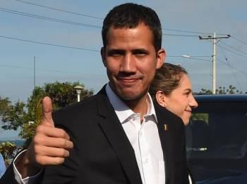 Guaido melanggar larangan perjalanan yang dikenakan terhadapnya bagi mengadakan pertemuan dengan pemimpin Paraguay, Argentina, Ecuador dan Brazil.- Foto AFP