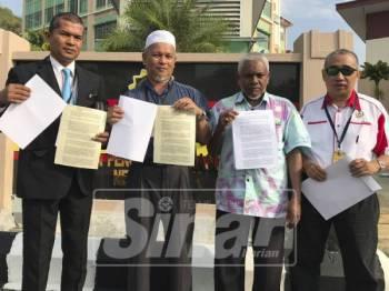 Omar (dua dari kiri) bersama ahli Jawatankuasa Bertindak Pendidikan Negeri membuat laporan SPRM berhubung penyalahgunaan kuasa berhubung pemilihan guru besar SJKC, hari ini.