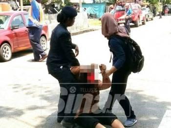 Gambar wanita yang ditahan polis ini tular di laman sosial dan memberi persepsi negatif kepada polis.