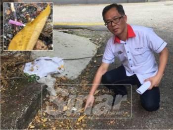Exco Kesihatan dan Anti Dadah negeri Low Chee Leong menunjukkan jarum suntikan yang ditemui dalam keadaan bersepah di belakang sebuah bangunan di Jalan Ong Kim Wee.