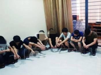Antara warga China yang ditahan dalam serbuan polis di Bandar Parklands petang semalam.