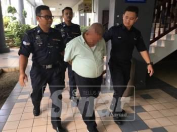 Tertuduh dibawa keluar dari mahkamah selepas didakwa enam pertuduhan merogol dan melakukan amang seksual terhadap anak sendiri di Mahkamah Sesyen, hari ini.