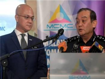 Mazlan (kanan) bersama Pengerusi Suruhanjaya Komunikasi dan Multimedia (MCMC) Al-Ishsal Ishak ketika sidang media selepas Mesyuarat Jawatankuasa Jenayah Bersama Polis Diraja Malaysia dan MCMC di Ibu Pejabat MCMC hari ini. - Foto Bernama