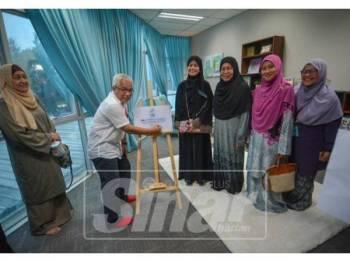 Hussamuddin ketika merasmikan Soul Fitness Centre (SFC), semalam. - FOTO SHARIFUDIN ABDUL RAHIM