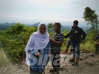 Gambar yang turut dikongsi menerusi Facebook menunjukkan Siti Maznah turut serta dalam misi pencarian di Bukit Batu Putih.