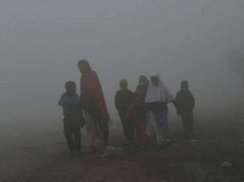 Pencemaran udara boleh memendekkan jangka hayat kanak-kanaks ehingga 30 bulan di Asia Selatan. - Foto AFP