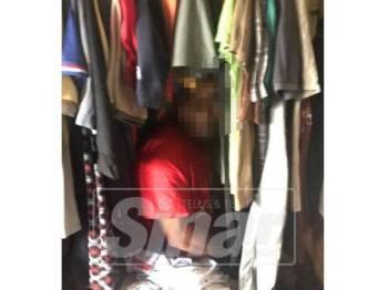 Lelaki terbabit menyorok dalam almari untuk mengelak ditahan.