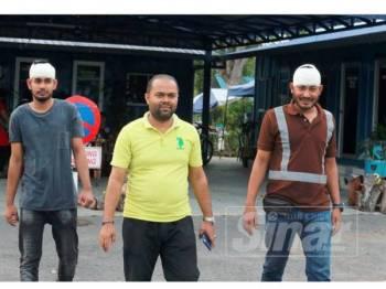 Lokendra (kanan) bersama rakannya ketika ditemui di Balai Trafik KLIA, hari ini selepas hadir untuk beri keterangan kepada pihak polis.
