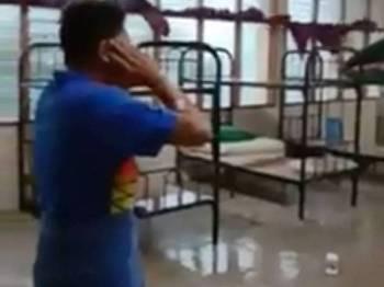 Paparan video seorang pelajar laungkan azan namun secara tiba-tiba petir menyambar mengakibatkan bekalan elektrik terputus. - Facebook Muhammad Izat Amir