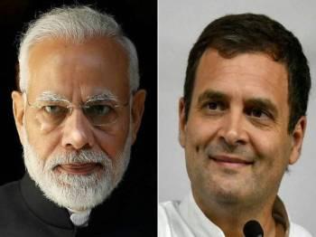 Perdana Menteri Narendra Modi daripada parti BJP (kiri) berdepan saingan hebat Presiden parti Kongres Kebangsaan India (INC) Rahul Ghandi dalam pilihan raya tujuh pusingan di India. - Foto AFP