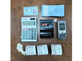 Kertas bercetak angka dan telefon bimbit antara barang yang dirampas dalam operasi yang dijalankan tengah hari, semalam.