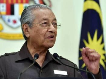 Perdana Menteri Tun Dr Mahathir Mohamad pada sidang media berkaitan projek Laluan Rel Pantai Timur (ECRL) di Bangunan Perdana Putra hari ini. Foto: Bernama