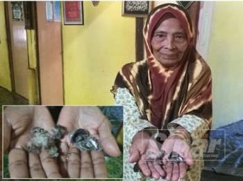 Aminah menunjukkan objek yang dipercayai punca letupan dan kebakaran bilik rumahnya di Kampung Lahar Batu. (Gambar kecil: Objek yang dipercayai menyebabkan letupan dan kebakaran bilik tidur dalam rumahnya.)