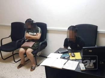 Dua warga Indonesia yang ditahan dalam Ops Dadu Khas di sebuah premis di Jalan Pudu, Kuala Lumpur, semalam.
