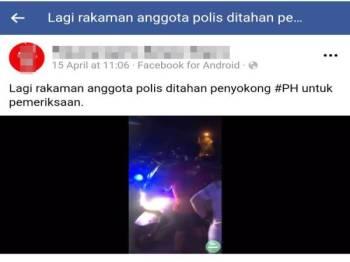 Orang awam menahan motosikal polis