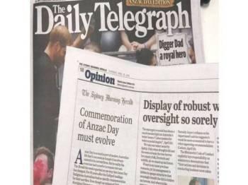 Akhbar tabloid The Daily Telegraph secara tidak sengaja mencetak halaman akhbar The Sydney Morning Herald dalam keluarannya. - Foto The Guardian