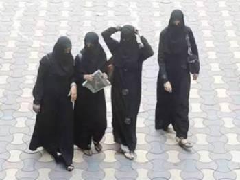 Pemakaian pakaian yang menutupi muka dilarang di kampus yang berada dalam kelolaan Persatuan Pendidikan Muslim (MES). - Gambar Hiasan