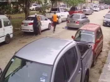 Suami mangsa mengejar kereta yang menyebabkan isterinya terseret apabila beg tangannya disamun.