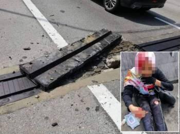 Keadaan laluan berkenaan yang dilaporkan rosak sebelum ini di KM26.4 Lebuhraya NKVE. (Gambar kecil: Keadaan mangsa yang mengalami kecederaan dalam kejadian itu.)
