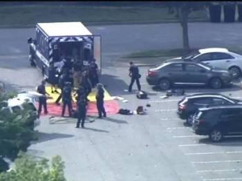 Sekurang-kurangnya 11 maut sementara enam lagi cedera dalam insiden tembakan rambang di bandar Virginia semalam. - Foto Twitter/Moorkk A